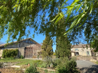 Substantial restored farmhouse with converted barn and 24ha