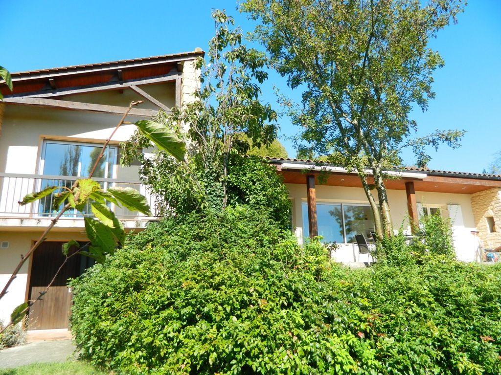 Modern village house with garage and large garden